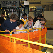 Group of visitors on a cyclotron tour