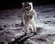 Picture of an astronaut on the moon during Apollo.