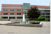 Picture of the outside of the MSU Main Library with the fountain.