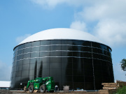 A picture of the South Campus Anaerobic Digester facility from the outside with a truck outside.