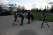 Using telescopes to view the stars.