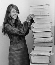 Margaret Hamilton with a stack of papers