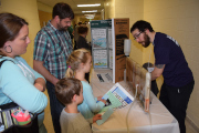 Presenters shows visitors where water comes from with visual display.